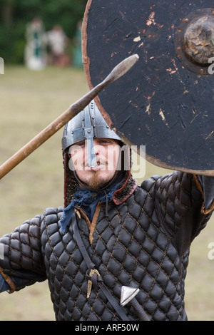 Viking warrior with spear and shield at a reenactment festival in Denmark - Stock Photo