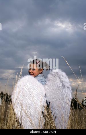 Girl wearing angel wings - Stock Photo