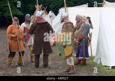 Viking warriors preparing for battle in camp at a viking re-enactment festival - Stock Photo