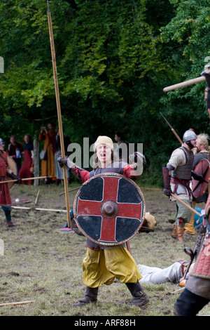 Victorious female viking warrior at a battle re-enactment in Denmark - Stock Photo