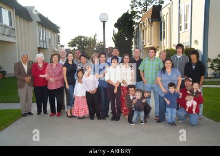 Three generations of a Hispanic Caucasian extended family - Stock Photo