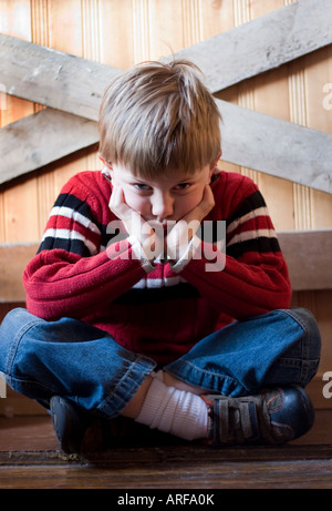 Child silking looking unhappy - Stock Photo