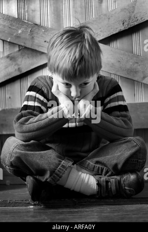 Child sulking looking sad and unhappy - Stock Photo