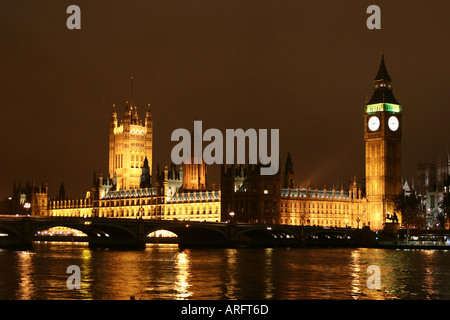 Houses of Parliament at night and Big Ben with relections in the River Thames - Stock Photo