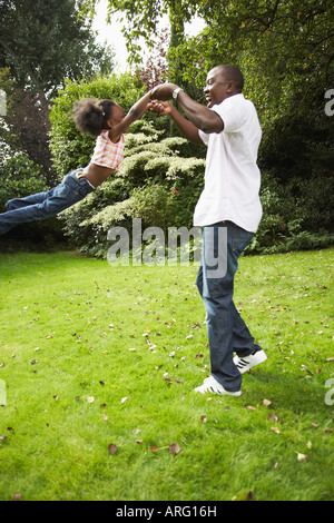 Man with Daughter in Backyard