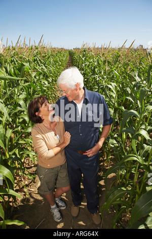 Portrait of Couple in Cornfield - Stock Photo