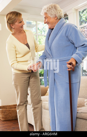 Senior Woman Receiving Assistance with Standing