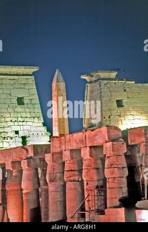 'Ancient Architecture' 'Luxor Egypt' General View of 'Luxor Temple' 'Lit Up' at Night Obelisk in Back - Stock Photo