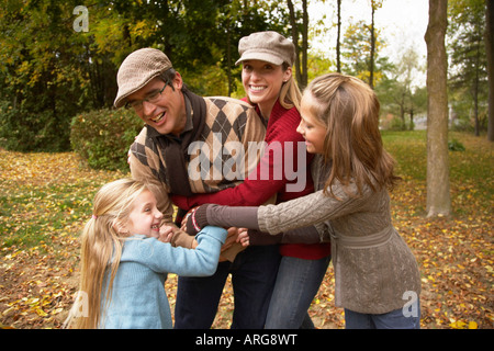 Portrait of Family Playing American Football, in Autumn - Stock Photo