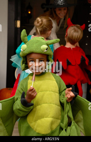 Portrait of Boy with other Children Trick or Treating at Halloween - Stock Photo