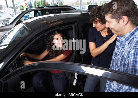 Teenager and Family Shopping For New Car