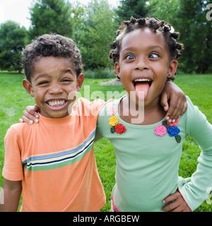 Siblings Goofing Around - Stock Photo