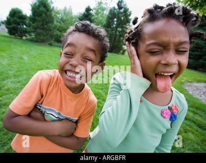 Siblings Making Faces - Stock Photo