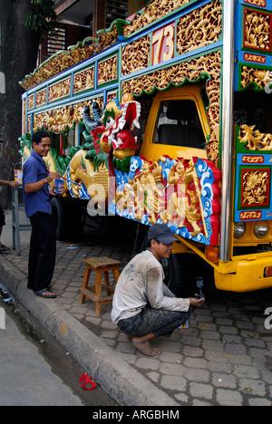 Isuzu 1973 truck being painted for Chinese new year,Phnom Penh,Cambodia - Stock Photo