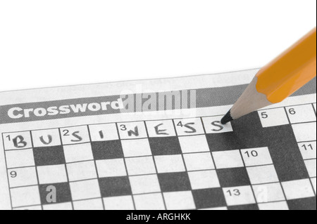 Business written on a crossword with a yellow pencil - Stock Photo