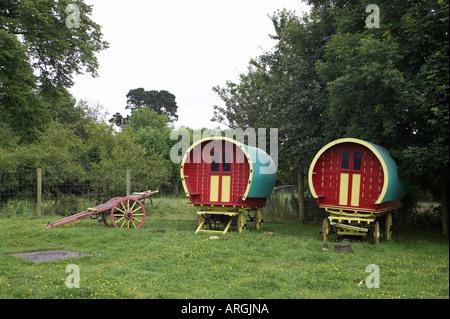 horse drawn irish gypsy travellers wagons in a field Bunratty Folk Park County Clare Republic of Ireland - Stock Photo