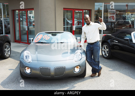 Portrait of New Car Owner - Stock Photo