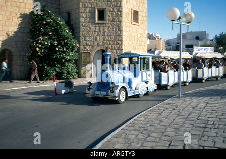 The familiar sight of a Noddy train conducting a group of tourists through the streets at Port El Kantaoui a custom - Stock Photo