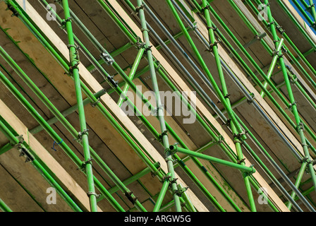 green scaffold poles used on construction site - Stock Photo