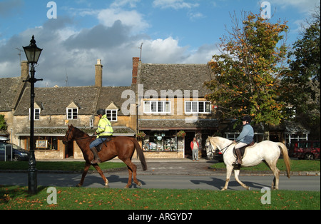Horse riders in The Cotswolds town of  Broadway west central England UK Europe - Stock Photo
