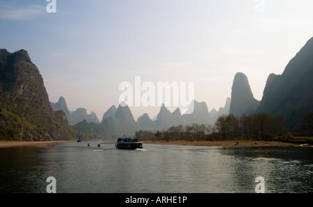 Tourist boat on Li Jiang river between Xingping and Yangshuo - Stock Photo