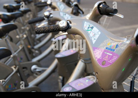 Rows of rental bikes lined up ready to be hired in Paris france - Stock Photo