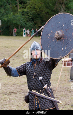 Aggressive viking warrior with spear and shield at a reenactment festival in Denmark - Stock Photo