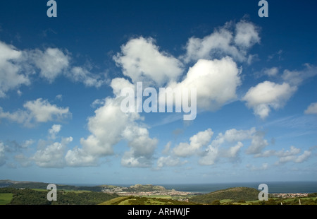 White clouds against a blue sky over countryside,North Wales,UK - Stock Photo
