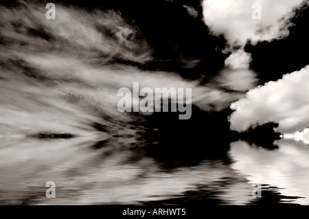 Black and white image of clouds reflected - Stock Photo