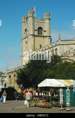 Cambridge university town Great St Marys Church tower beyond Market Hill stalls - Stock Photo