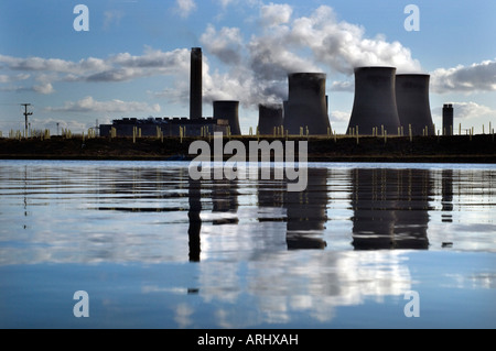 Clouds of steam rise from the cooling towers of the dual coal fired and gas turbine Didcot power station Oxfordshire - Stock Photo