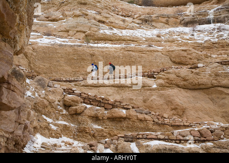 Grand Canyon National Park Arizona Two hikers descend the South Kaibab Trail in the Grand Canyon in winter - Stock Photo