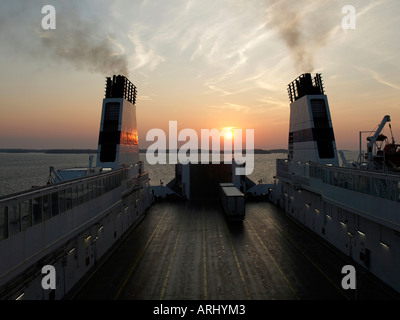truck on car deck of the ferry ship Finnclipper of Finnlink on passage from Finland to Sweden in sunset - Stock Photo