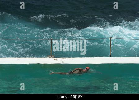 A lone swimmer at the Bondi Icebergs pool, Bondi Beach, Sydney, New South Wales, Australia - Stock Photo