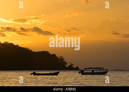 Boats moored in front of Isla Santa Catalina seen from Santa Catalina Panama - Stock Photo