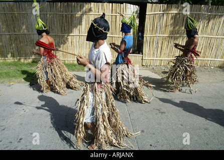 Penitent Filipinos flagellate themselves with bamboo whips on Good Friday in Mansalay, Oriental Mindoro, Philippines. - Stock Photo