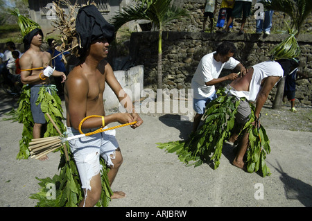 Penitents have their backs cut during the annual scourging ritual on Good Friday in Mansalay, Oriental Mindoro, - Stock Photo