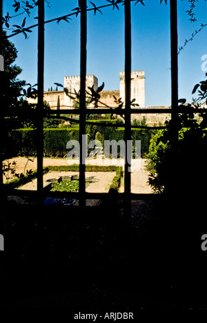 View of the Alhambra through a gate from the outside. - Stock Photo