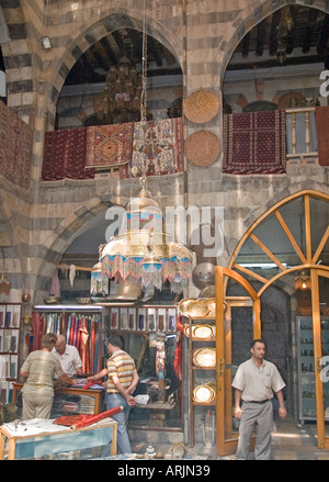 Interior of large shop, crowded market of al-Hamidiyya souk, souq, district of Damascus, Syria, Middle East. DSC - Stock Photo