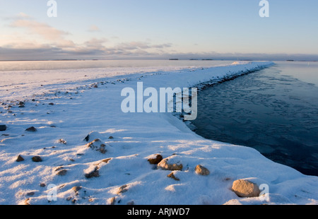 Oulu harbor's breakwater in a cold Winter day when the sea is about to freeze over , Finland - Stock Photo