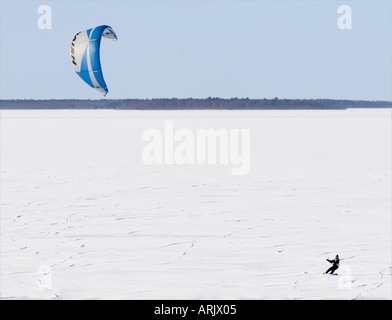 Kite boarding on sea ice at Bothnian Bay at Winter , Finland - Stock Photo