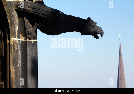 A gargoyle of the Gothic St. Nikolai Church in Hamburg, Germany, the church is a war memorial as it was destroyed - Stock Photo