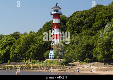Beach and lighthouse at the river Elbe in the quarter Rissen/ Wittenbergen. Hamburg, Germany - Stock Photo