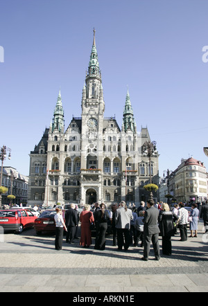 Group of wedding guests gathering in front of the town hall building in Liberec, Czech Republic. - Stock Photo