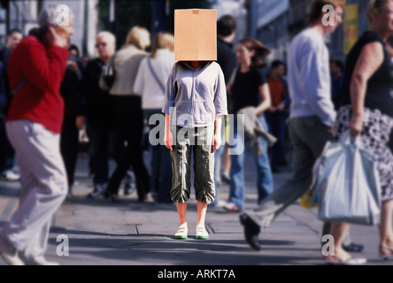 girl in street with box on head - Stock Photo