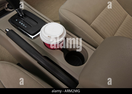 2008 Ford Fusion S in White - Cup Holder with Prop - Stock Photo
