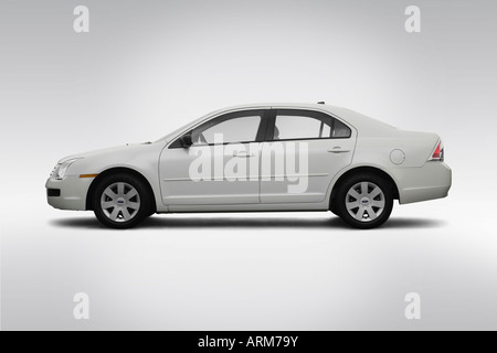 2008 Ford Fusion S in White - Drivers Side Profile - Stock Photo