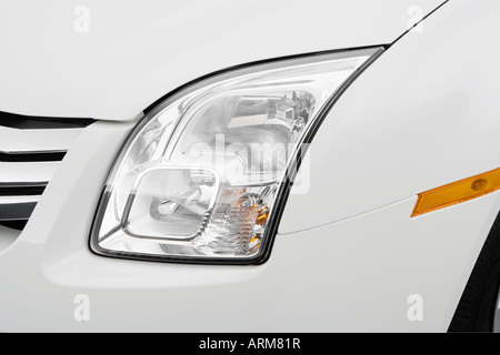 2008 Ford Fusion S in White - Headlight - Stock Photo