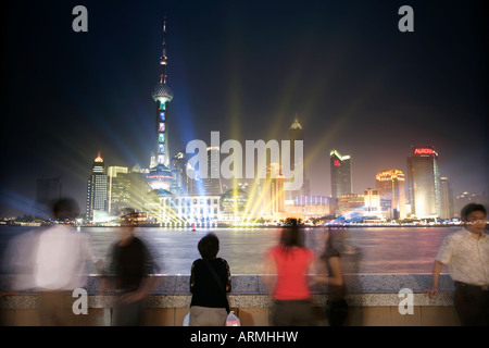 People on the Bund looking at the Oriental Pearl Tower in Pudong District, Shanghai, China, Asia - Stock Photo