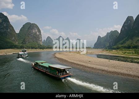 Cruise boats on Li River, between Guilin and Yangshuo, Li River, Guilin, Guangxi Province, China, Asia - Stock Photo